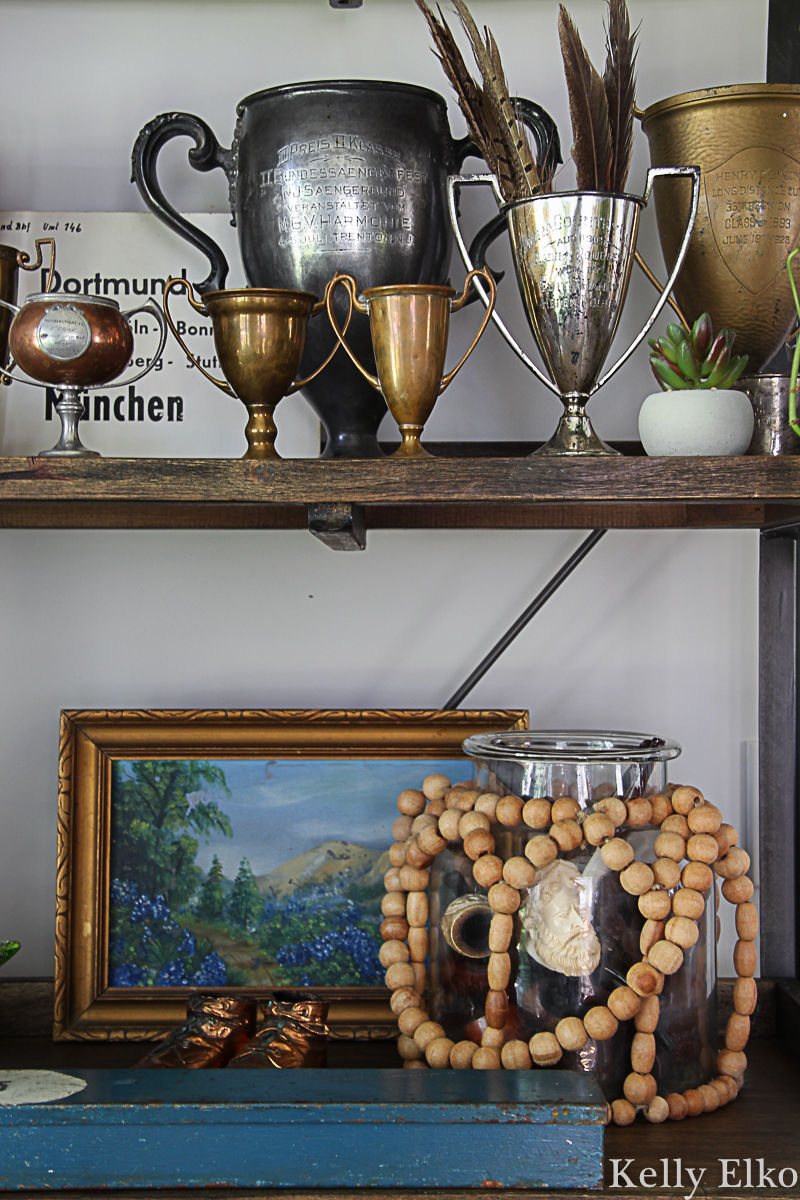 Love her unique collections like these antique loving cups kellyelko.com #lovingcups #trophy #vintagedecor #antiquedecor #collections #vintagecollections #patina #falldecor