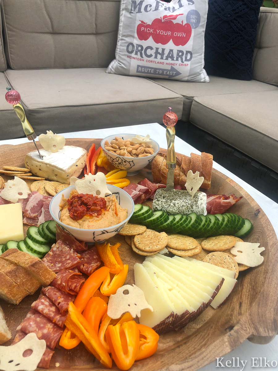 This fall charcuterie board is epic! I love the little ghost shaped crackers kellyelko.com #charcuterie #charcuterieboard #cheeseplatter #cheeseboard #meatandcheese #appetizers #partyfood #boards #fallfood #fallparty #fallcharcuterie #partyfood