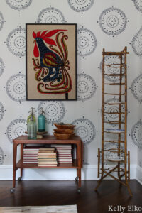 Love this beautiful antique bamboo plate rack and Danish modern bar cart in this eclectic dining room kellyelko.com #platerack #vintagedecor #danishmodern #barcart #bamboo #vintagebamboo #antiques