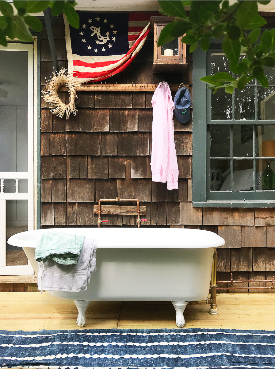 Tour this charming beach cottage with outdoor clawfoot bathtub kellyelko.com