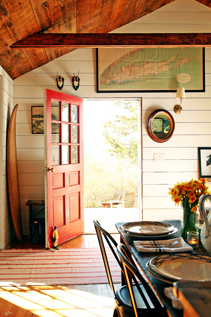 This charming cottage has a bright red door to welcome visitors kellyelko.com