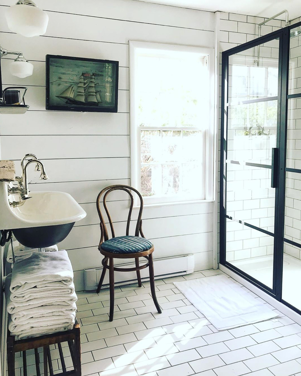 Classic subway tile is unexpected on the floor of this charming cottage kellyelko.com