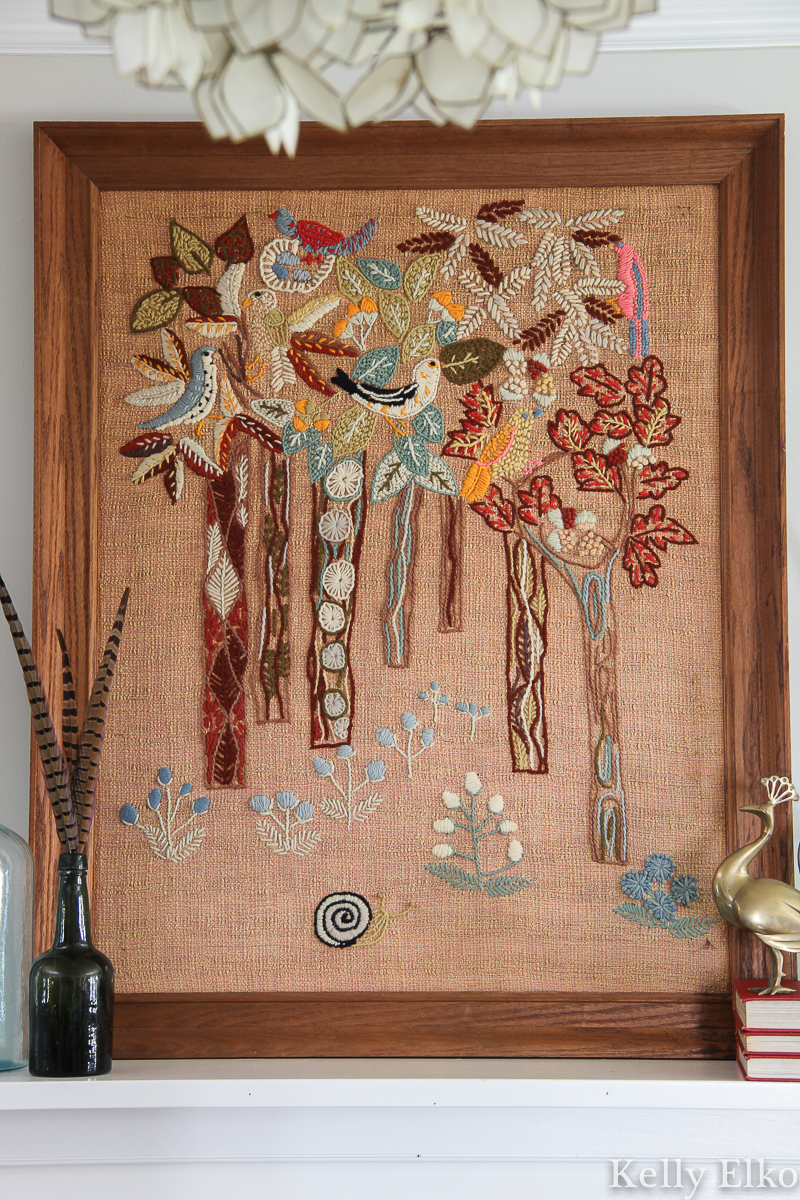 This is a fantastic example of Erica Wilson crewel work - I love the details on the birds and trees kellyelko.com #crewel #crewelart #art #vintageart #vintagedecor #kitsch #retro #vintagedecor #ericawilson #eclecticdecor