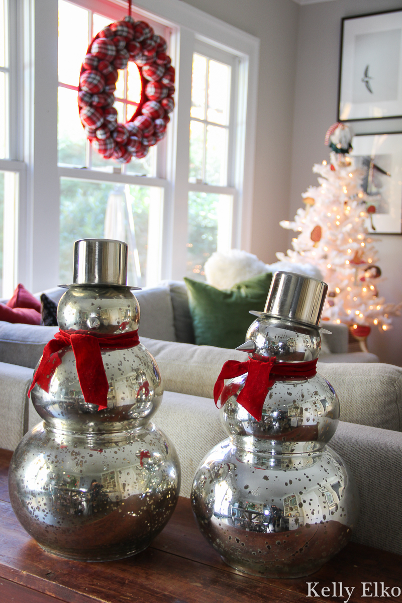 Beautiful Christmas home tour - love the mercury glass snowman kellyelko.com #mercuryglass #snowman #christmasdecor #colorfulchristmas #farmhousechristmas #christmaswreath #christmashometour #whitechristmastree