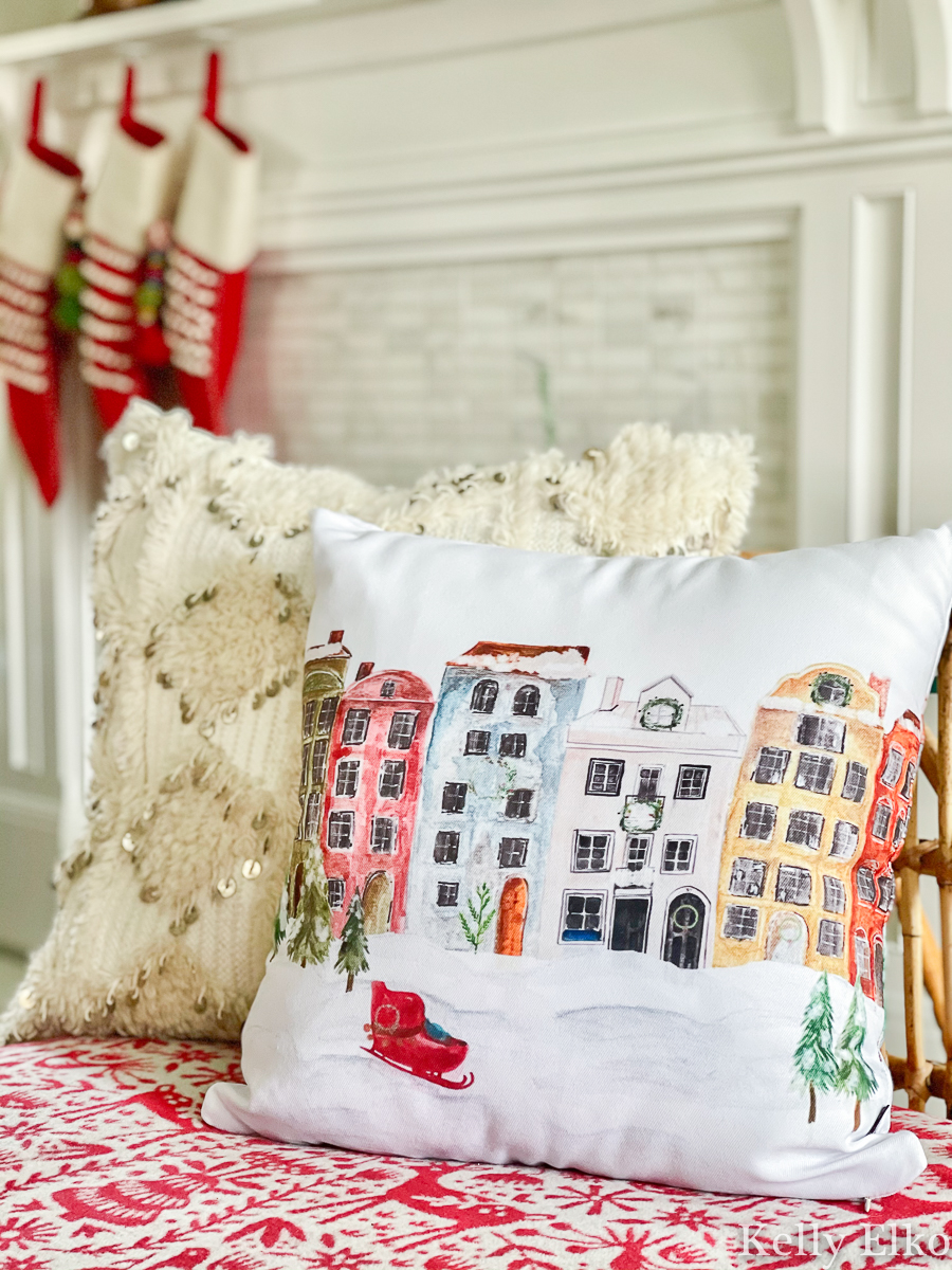 Love this colorful row of houses Christmas pillow kellyelko.com #pillow #christmaspillow #winterpillow #farmhousechristmas #colorfulchristmas #retrochristmas #vintagechristmas #christmashometour