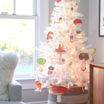 Love this white Christmas tree with DIY mushroom ornaments kellyelko.com #christmas #christmasornaments #retrochristmas #christmascrafts