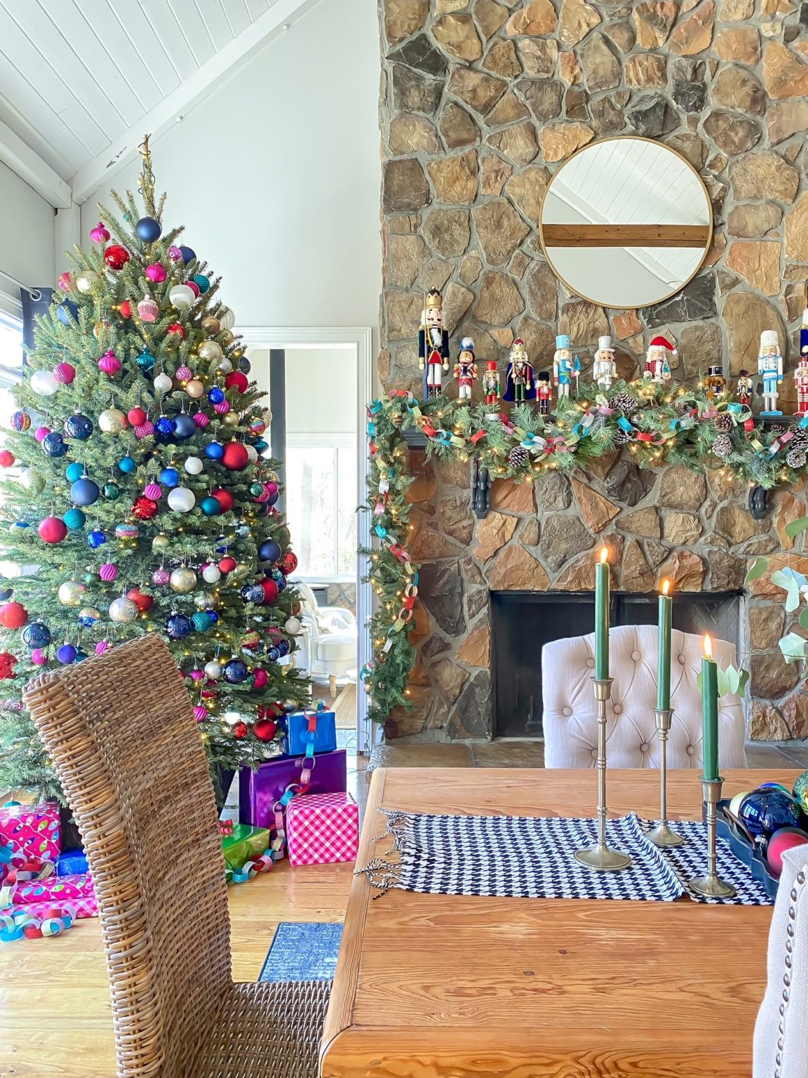 Love this colorful Christmas tree and mantel #colorfulchristmas #christmastree #nutcrackers #christmasmantel