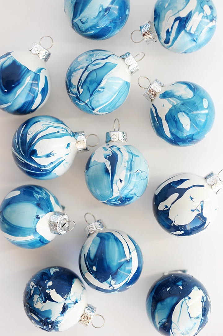 Unique DIY Ornaments - I love these marbled ornaments made using nail polish