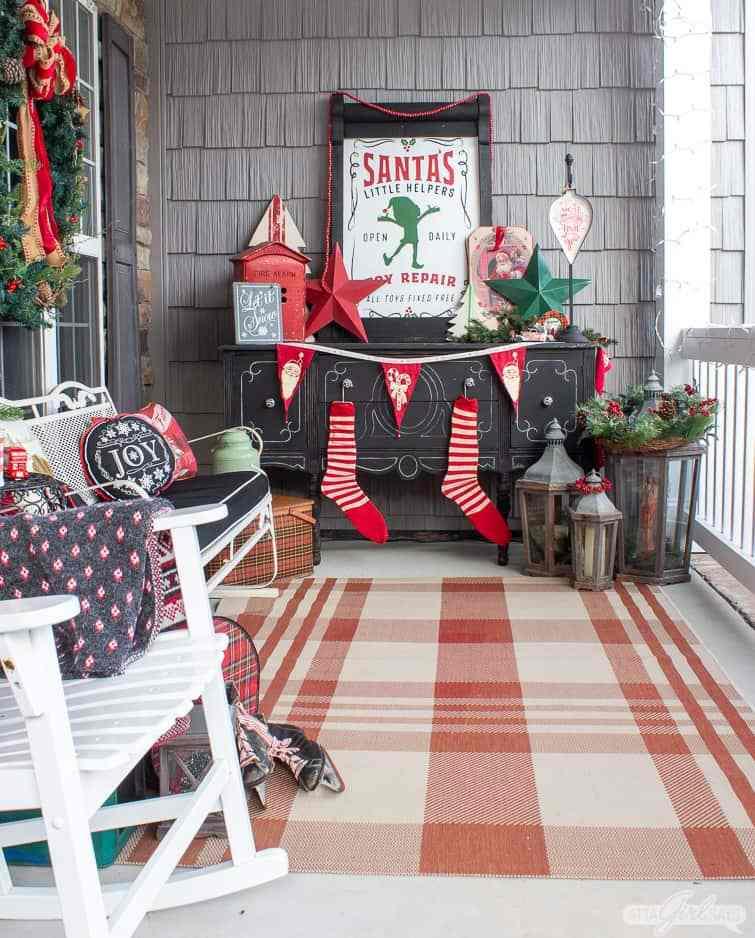 Love this whimsical Christmas porch #christmas #christmasporch #outdoorchristmasdecor #vintagechristmas #retrochristmas #diychristmas