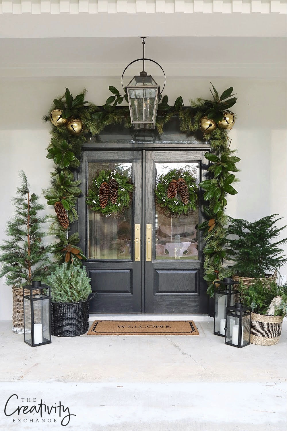 Love this classic Christmas porch with a twist! The giant pine cones and jingle bells add a festive touch #christmas #christmasporch #outdoorchristmasdecor #farmhousechristmas #classicchristmas #diychristmas #christmaswreath