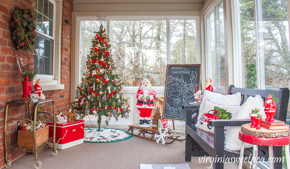 Love this fun retro Christmas porch with Santa blow mold and vintage finds #christmas #christmasporch #vintagechristmas #retrochristmas #outdoorchristmasdecor