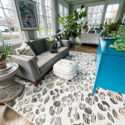 Ruggable Rug Honest Review - kellyelko.com #ruggable #ruggablerug #sunroom #eclecticdecor #leopard #leopardprint #leopardrug #plantslady #houseplants #vintagedecor #jungalow