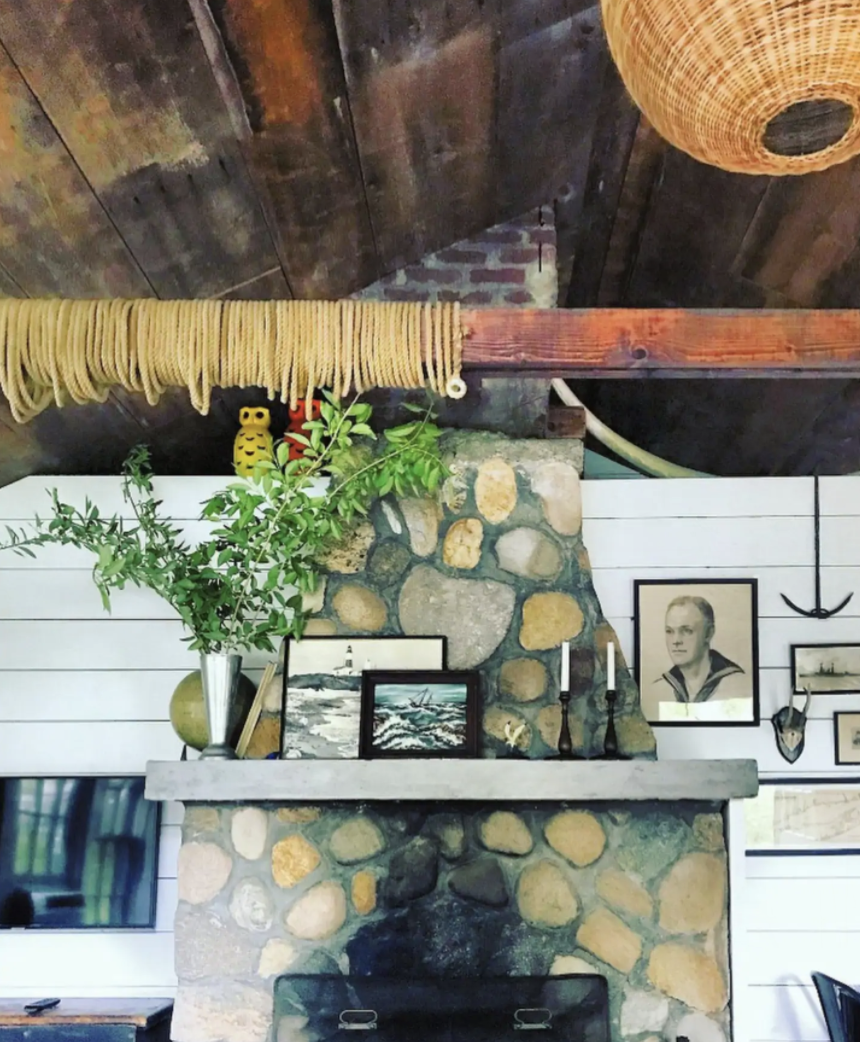 Rustic stone mantel in this charming cottage kellyelko.com