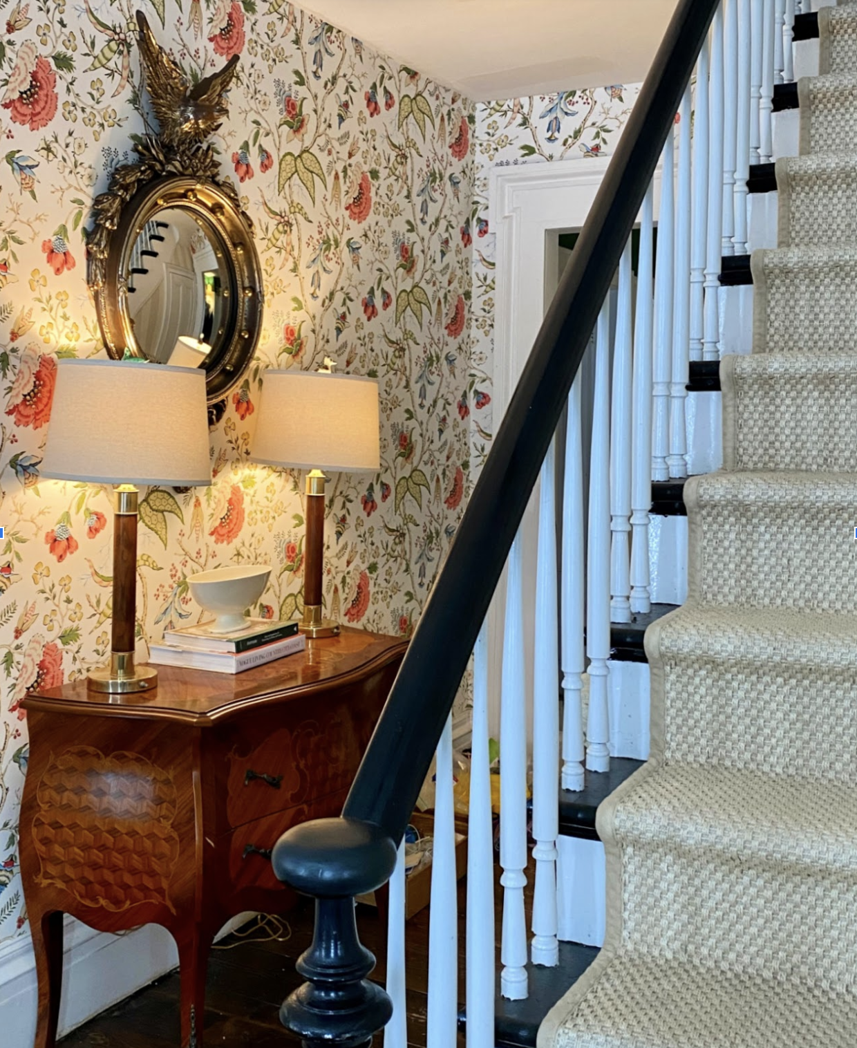 Beautiful foyer with colorful floral wallpaper in this 200 year old farmhouse