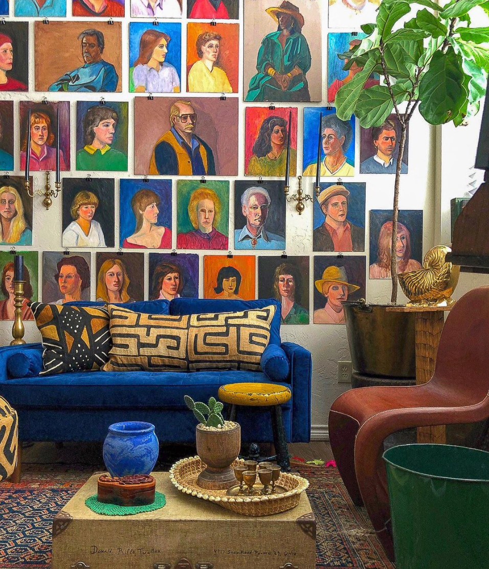 Love this colorful collection of vintage portrait paintings hung with binder clips! kellyelko.com
