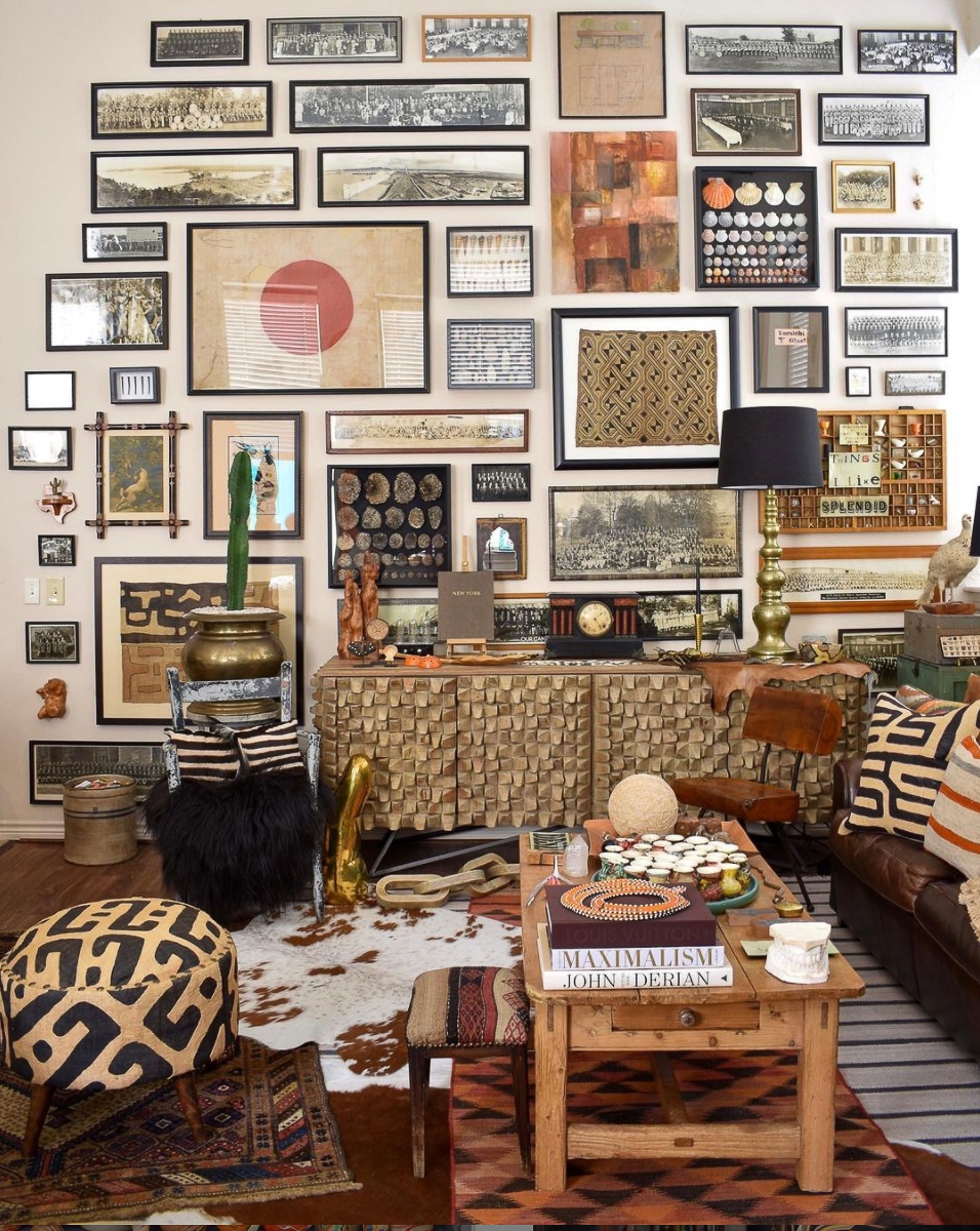 Tour this collectors home filled with unique decorating ideas like this vintage photo gallery wall kellyelko.com