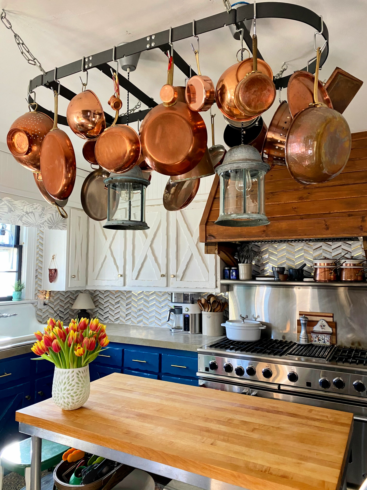 Eclectic Home Tour of Farmhouse 1820 - love the copper pots hung over the kitchen island