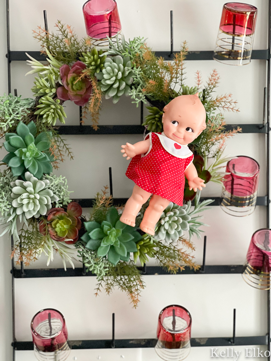 Love this adorable little vintage Kewpie doll on a succulent wreath kellyelko.com