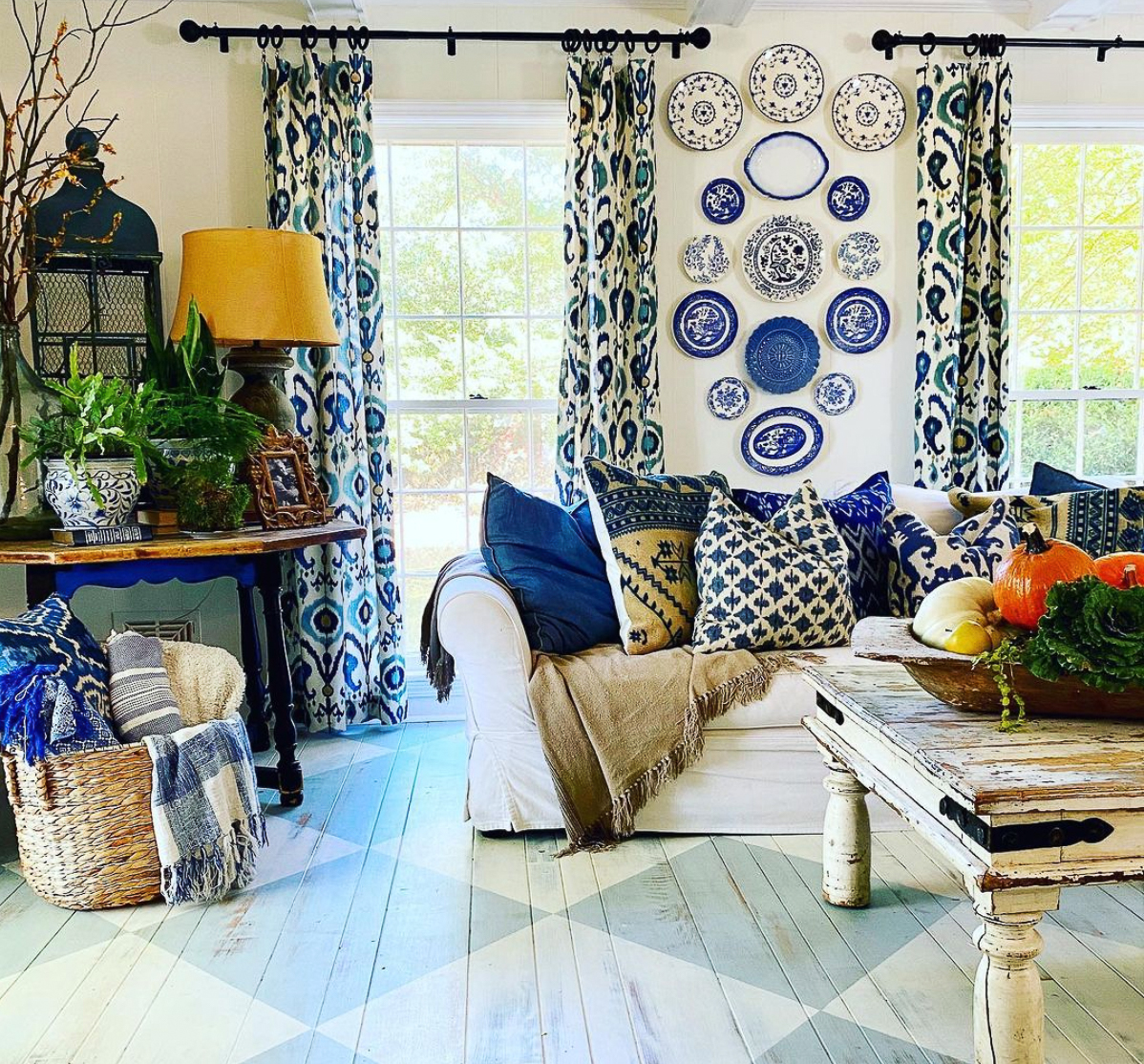 Love this soothing blue room with hand painted diamond pattered wood floors and beautiful plate wall