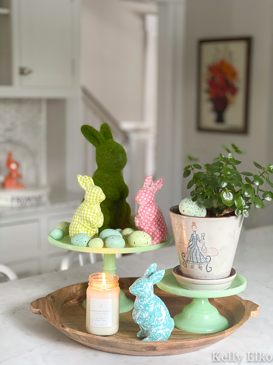 Spring home tour - love the colorful bunnies and eggs display kellyelko.com