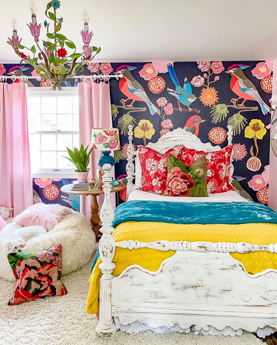 Love this colorful girls bedroom with bird mural
