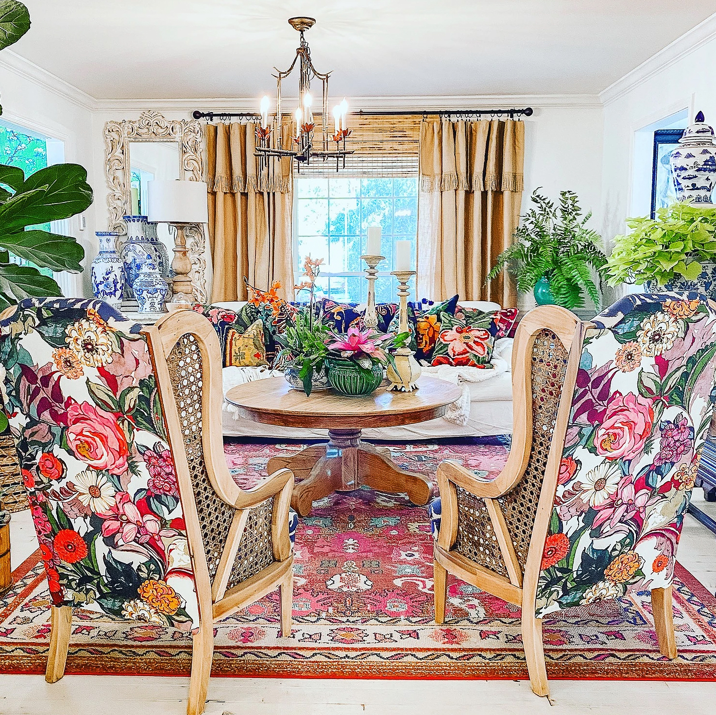 Colorful living room with thrifted cane chairs reupholstered in a fun and whimsical floral fabric
