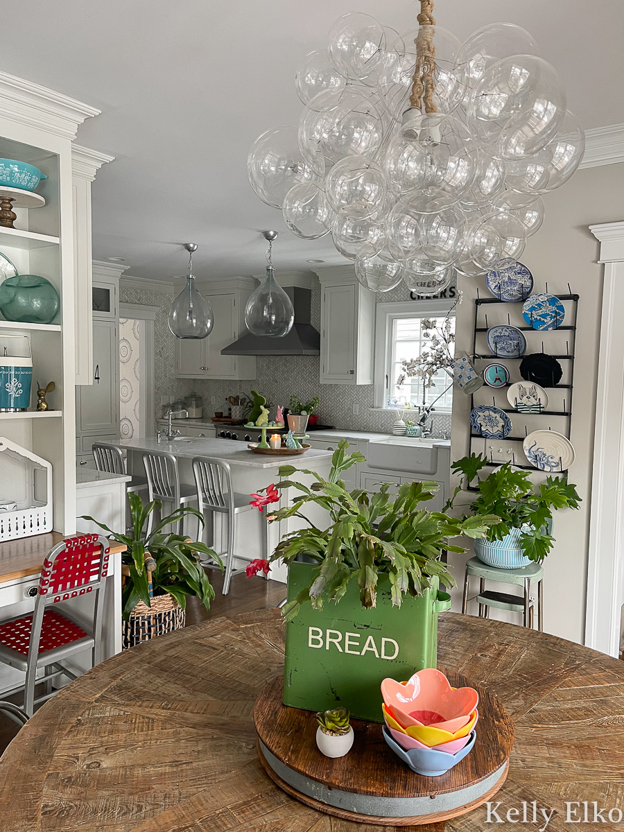 Eclectic spring home tour - love this bubble chandelier and her vintage displays kellyelko.com