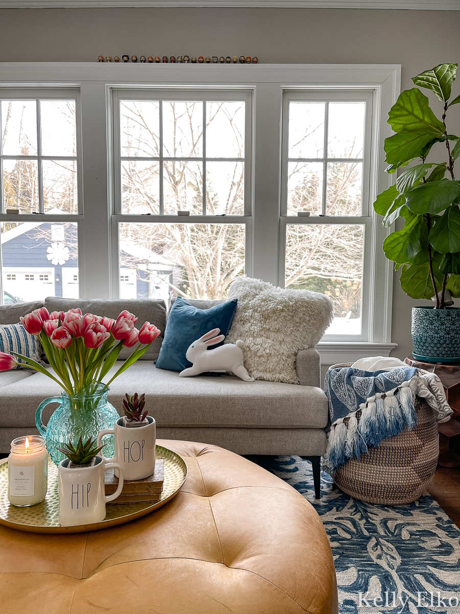 I love this colorful and eclectic family room for spring and the adorable little bunny pillow! kellyelko.com
