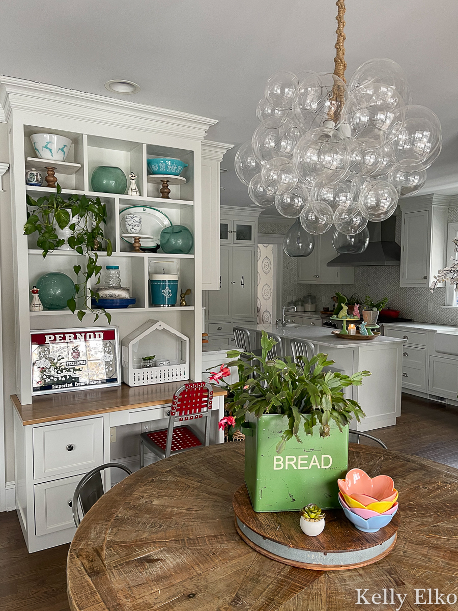 Gorgeous farmhouse kitchen with whimsical bubble chandelier kellyelko.com