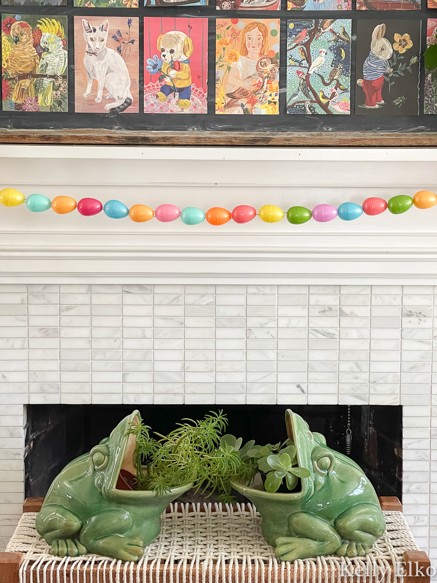 This spring mantel with egg garland and frog planters is adorable kellyelko.com