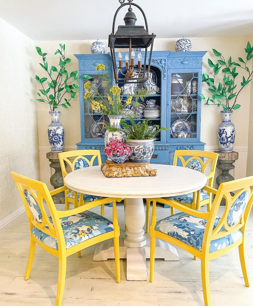 Vintage furniture takes on a new life painted bold colors in this dining room