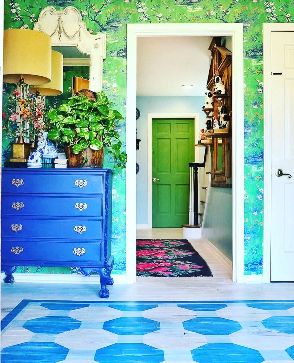 Colorful home tour - love the hand painted wood floor and the green wallpaper in this stunning foyer