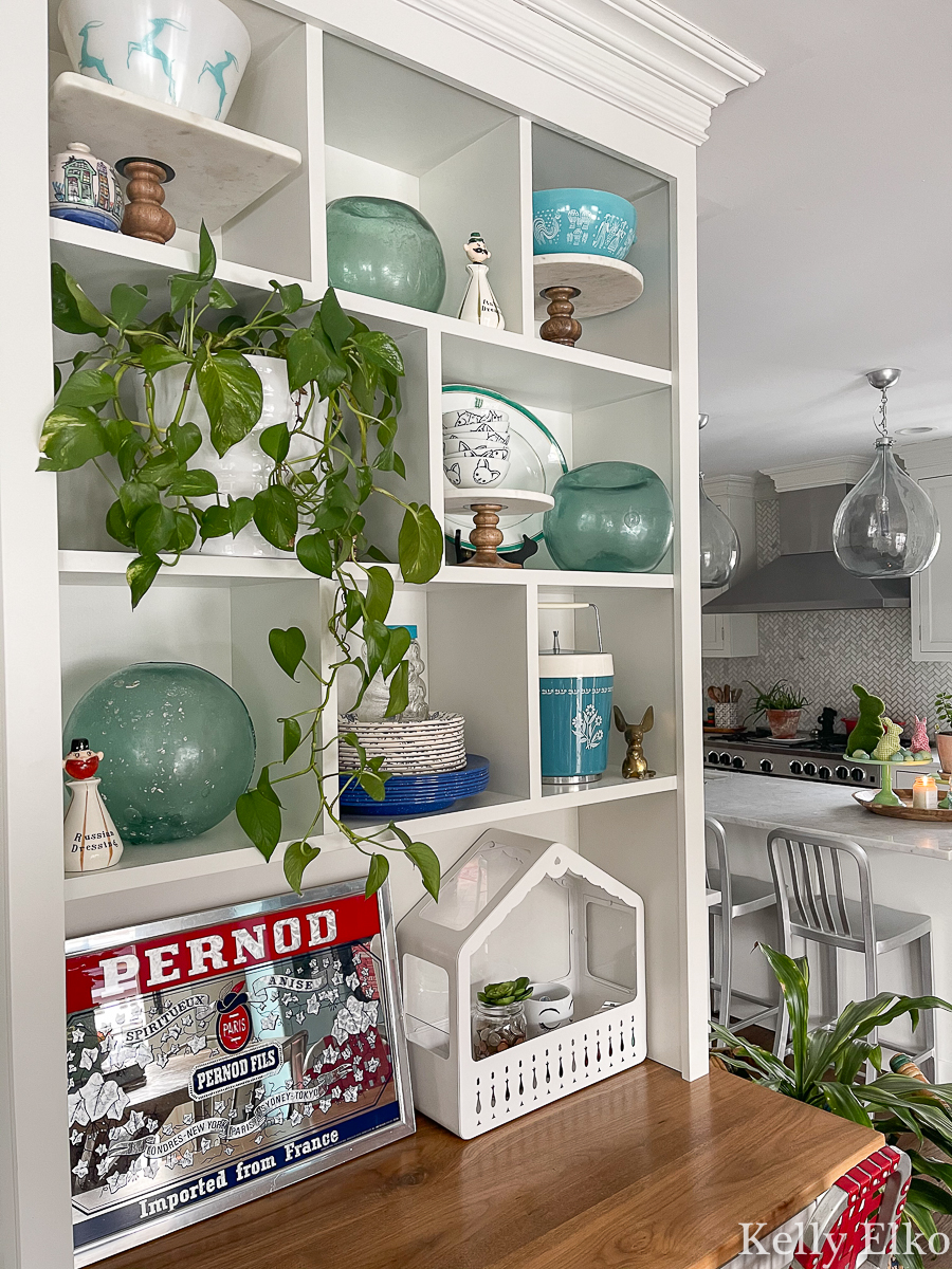 Love this open shelf display of vintage finds including old glass fishing buoys kellyelko.com