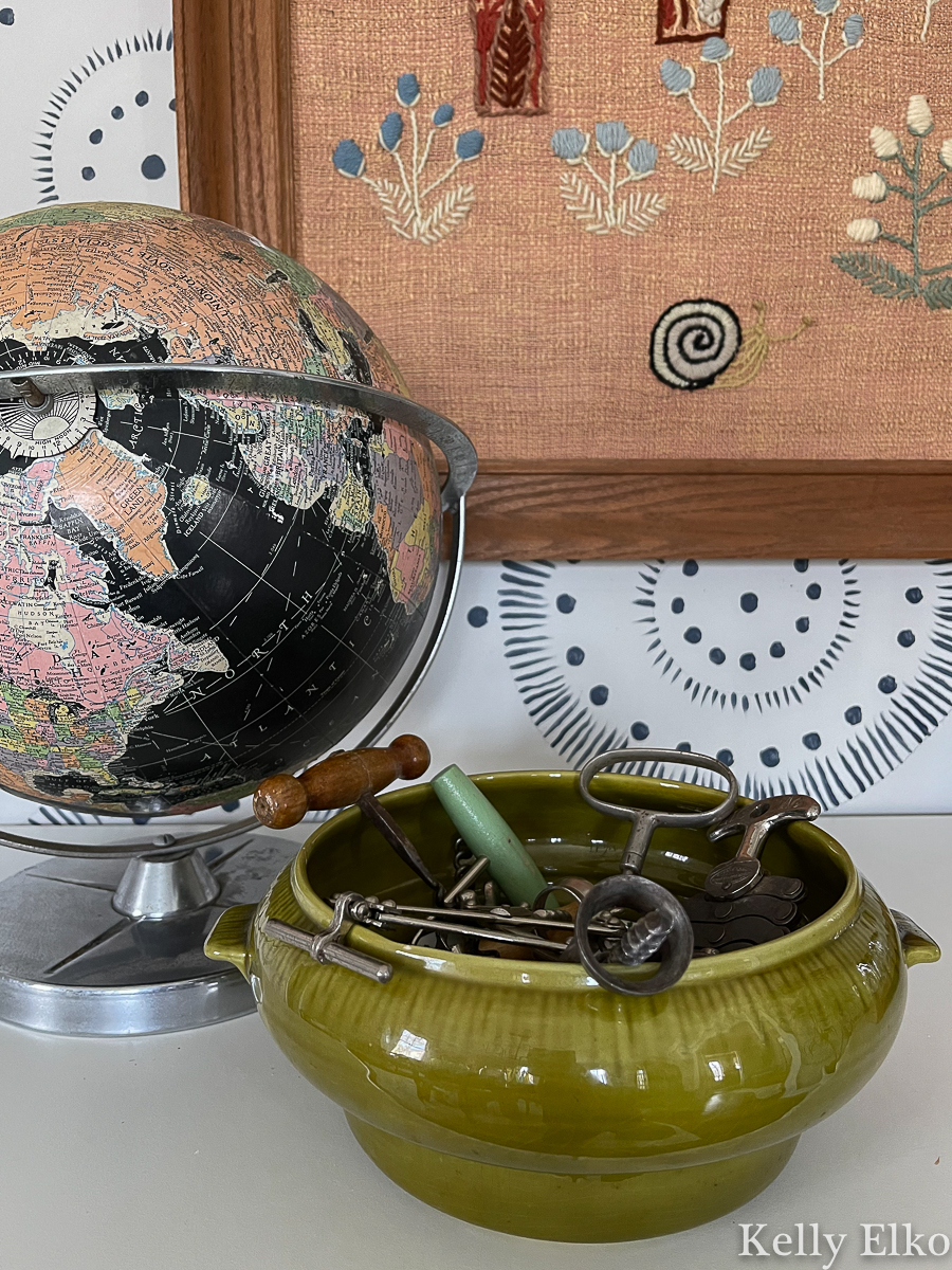 Decorate with vintage - love the black globe and green pottery bowl filled with vintage corkscrews kellyelko.com