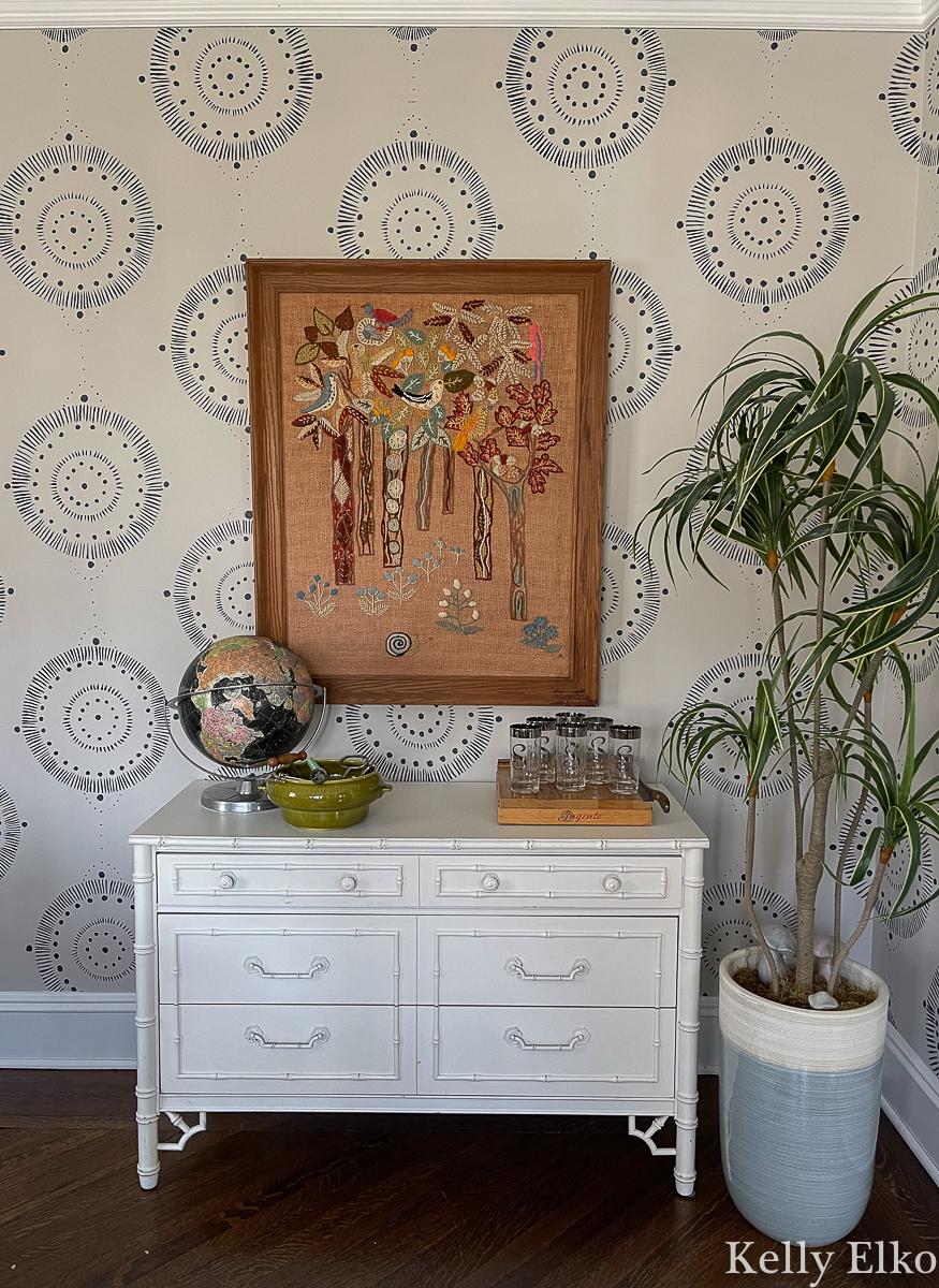 Beautiful vintage display in the dining room - love the huge crewel art kellyelko.com