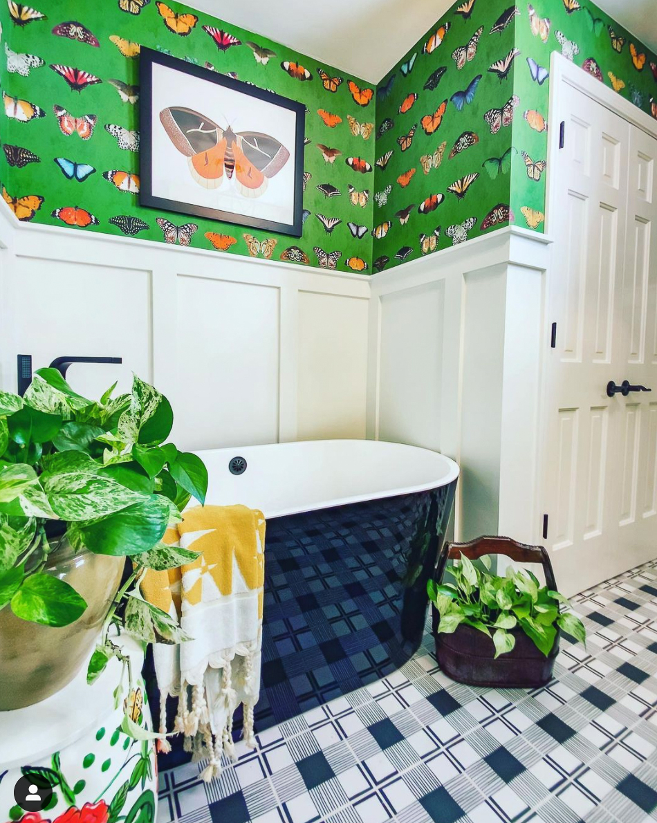 Amazing bathroom transformation with butterfly wallpaper and black and white tile