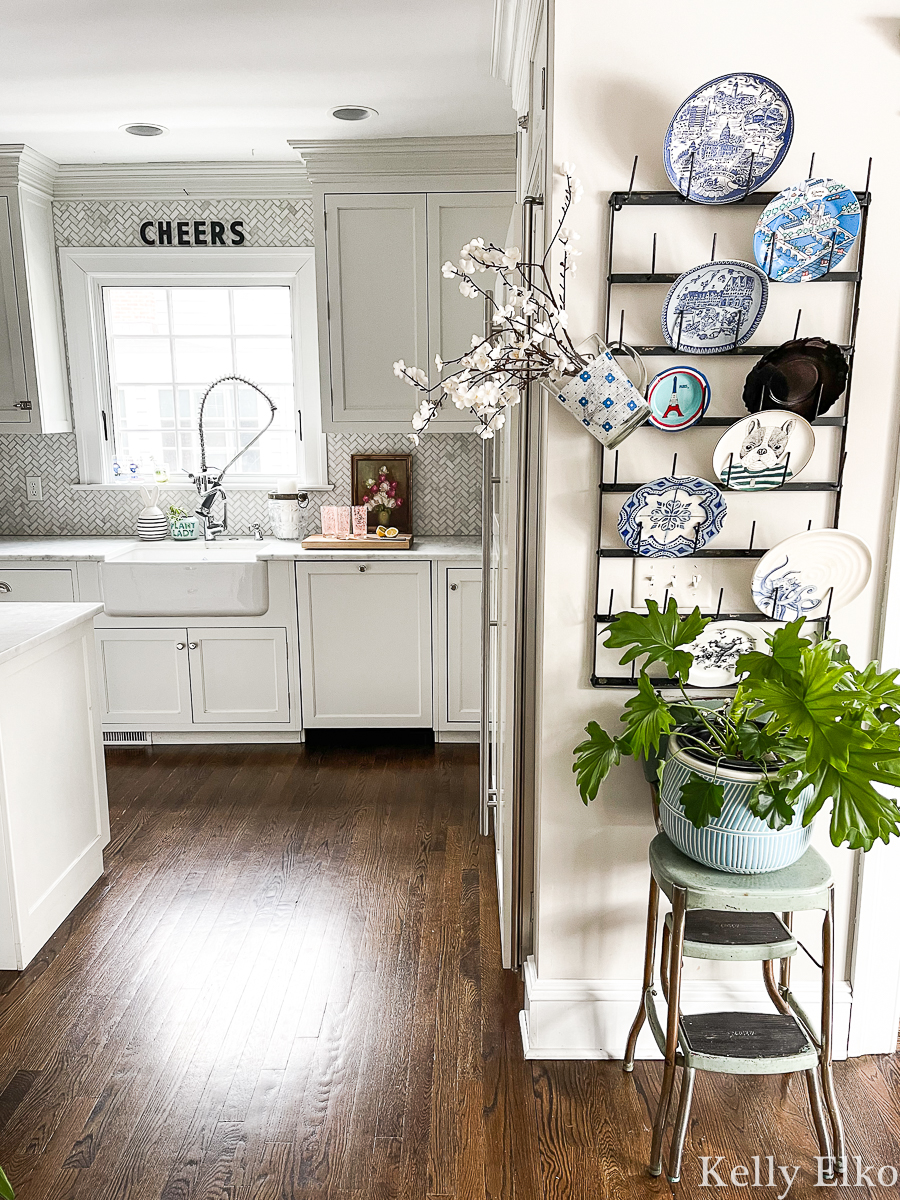 Beautiful white farmhouse kitchen with eclectic plate wall display kellyelko.com