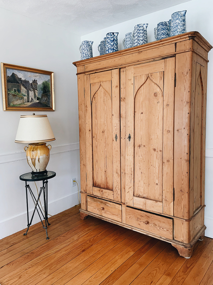 Gorgeous bleached pine armoire with a collection of blue sponge ware kellyelko.com