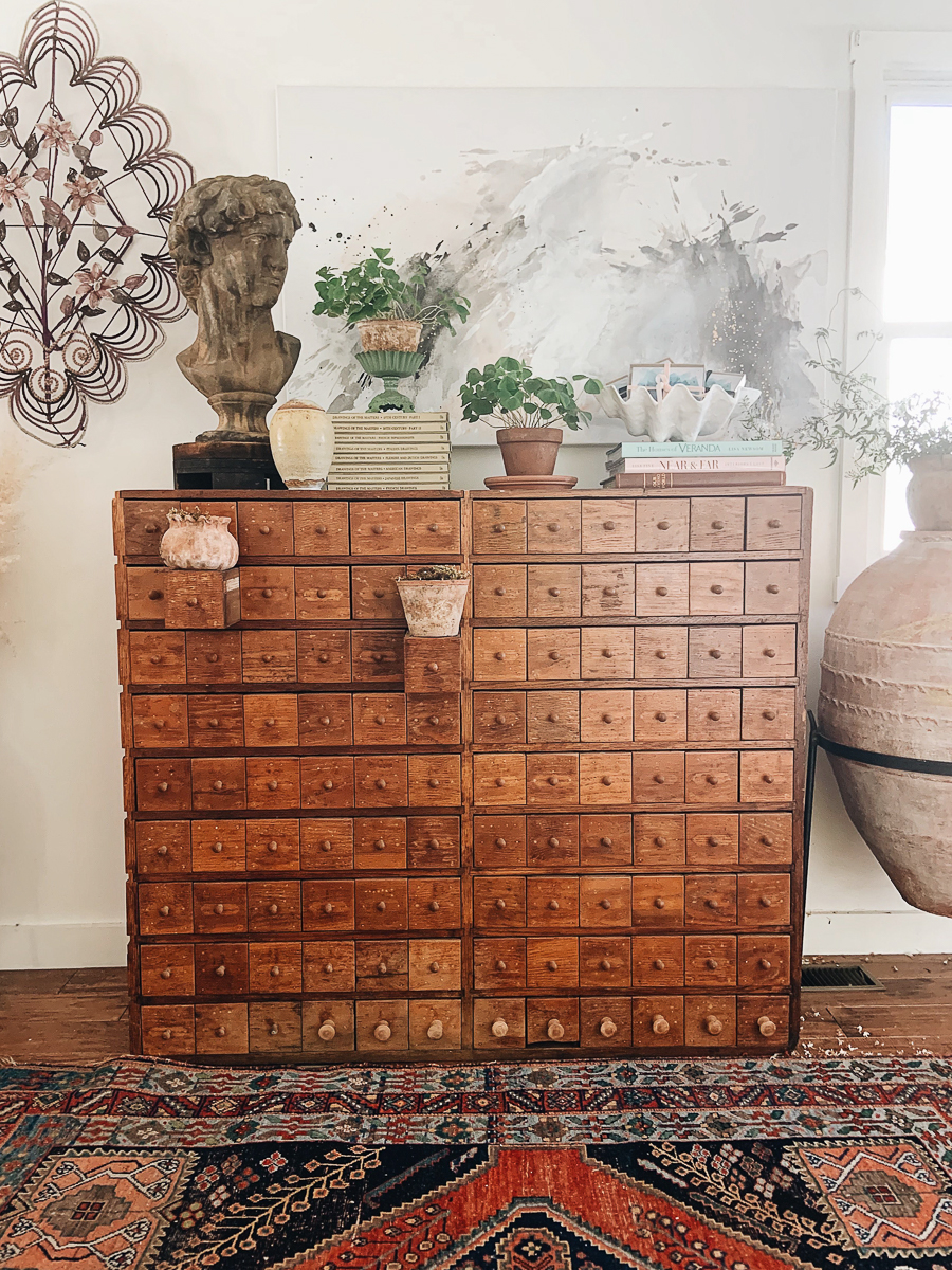 Stunning antique apothecary chest and French mourning wreath in this beautiful farmhouse kellyelko.com