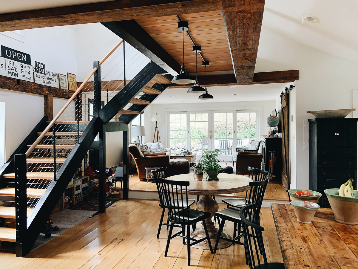 Beautiful modern staircase with wire banister in this modern farmhouse kellyelko.com