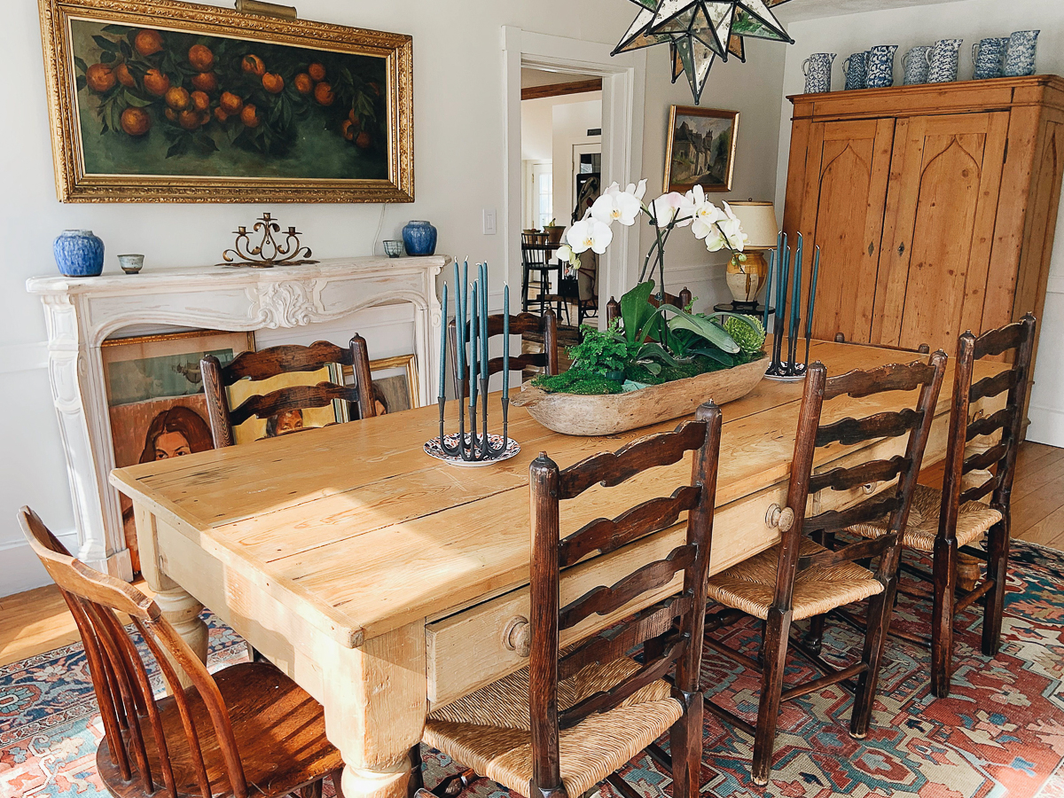 Rustic farmhouse dining room with antique table and chairs and original art kellyelko.com