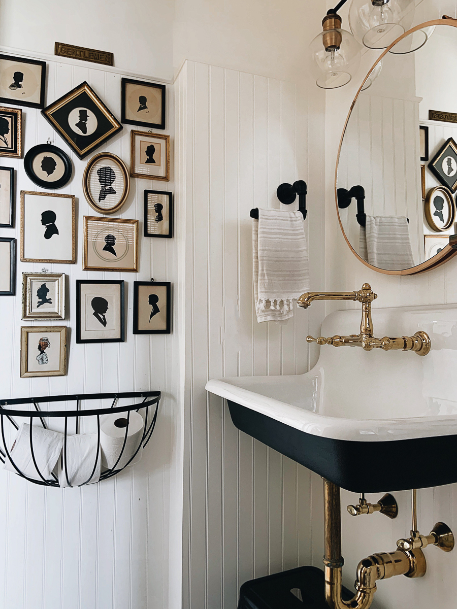 Black white and brass bathroom with antique silhouette art gallery wall kellyelko.com