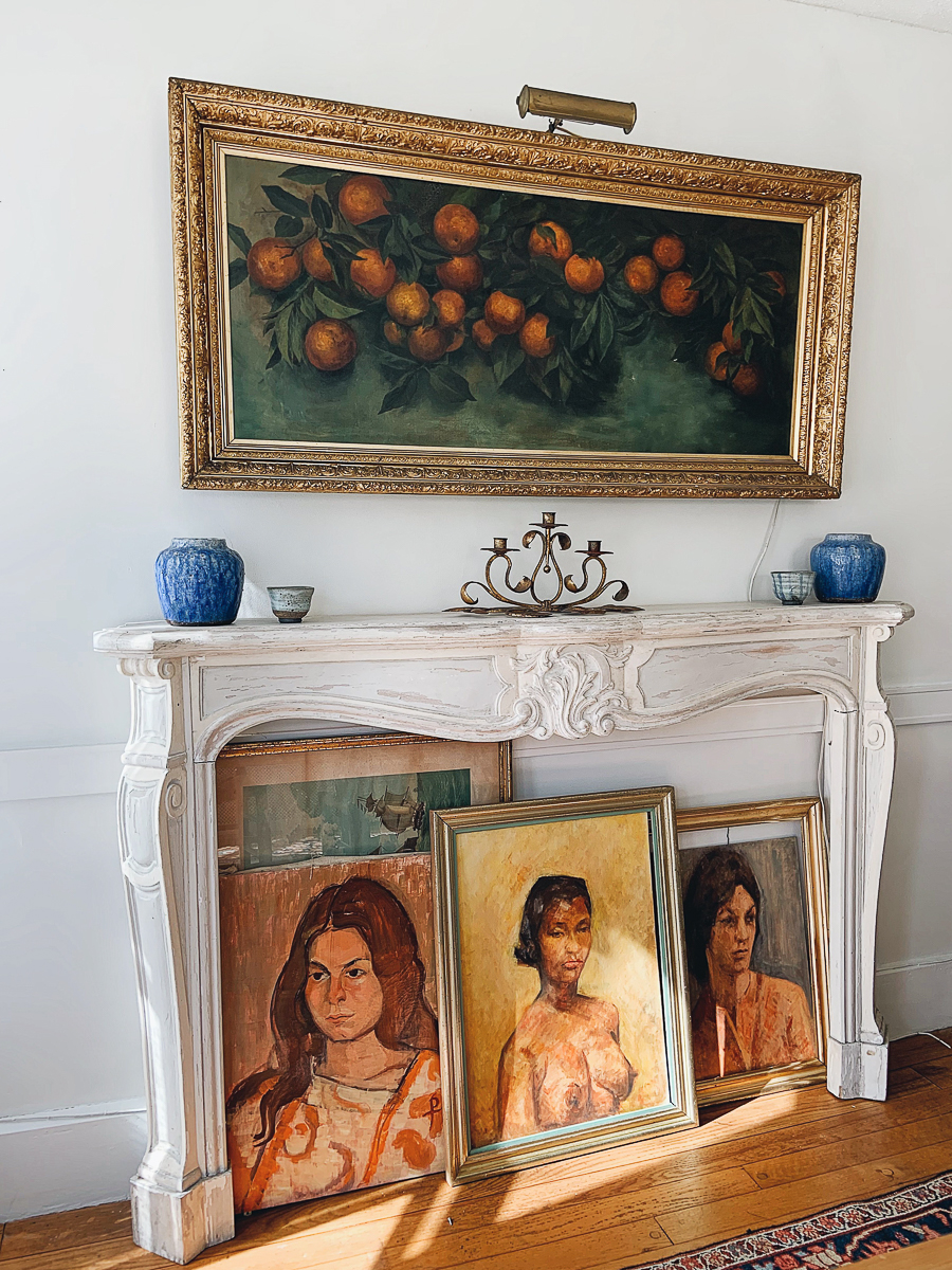 Love this faux fireplace with vintage portraits tucked underneath kellyelko.com