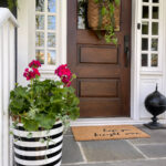 Love this porch and trash can planter kellyelko.com