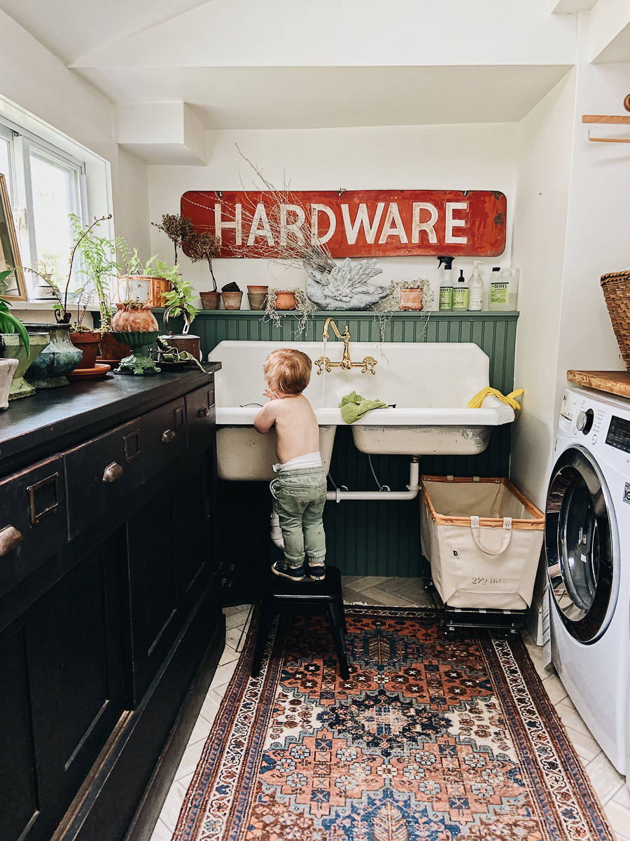 Love this laundry room / potting room complete with antique cabinet, old sink and huge old sign kellyelko.com