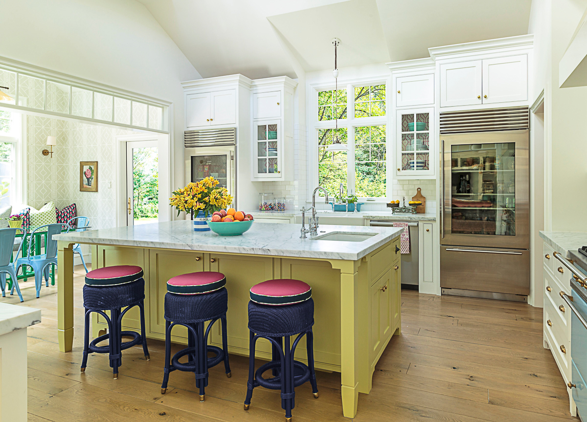 Eclectic Home Tour of Polished Farmhouse - love the yellow kitchen island and the glass front refrigerator kellyelko.com