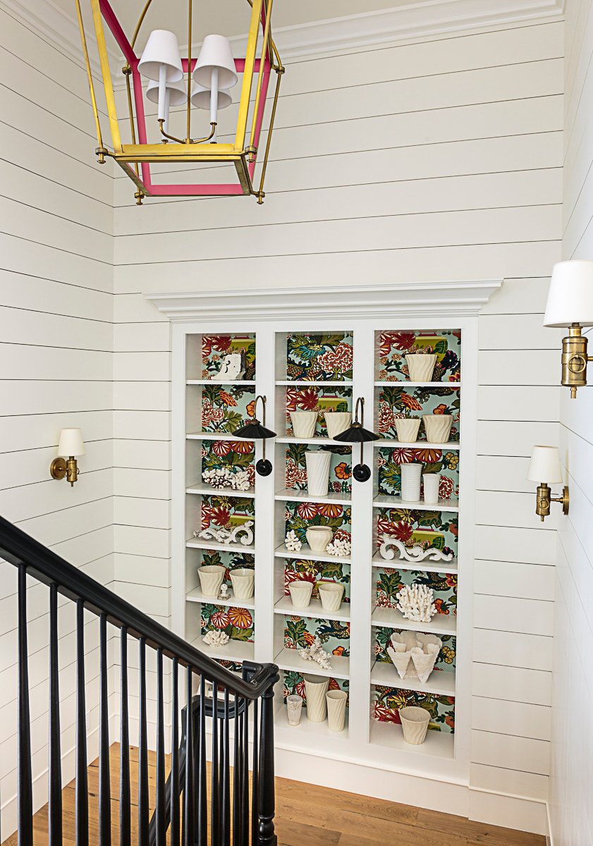 Love the built in bookcase on the staircase and the shiplap kellyelko.com