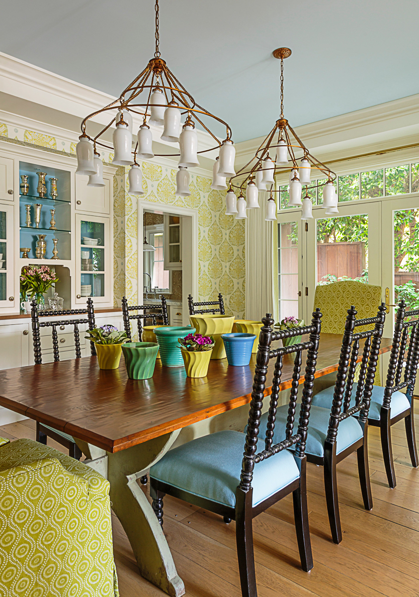 Beautiful and colorful dining room with stunning pair of chandeliers and built in chine cabinet kellyelko.com