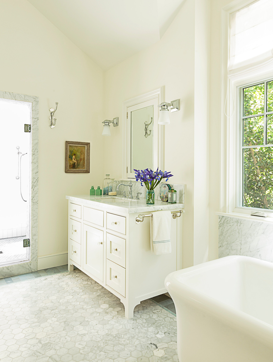 Love this white bathroom with marble floor and freestanding tub kellyelko.com