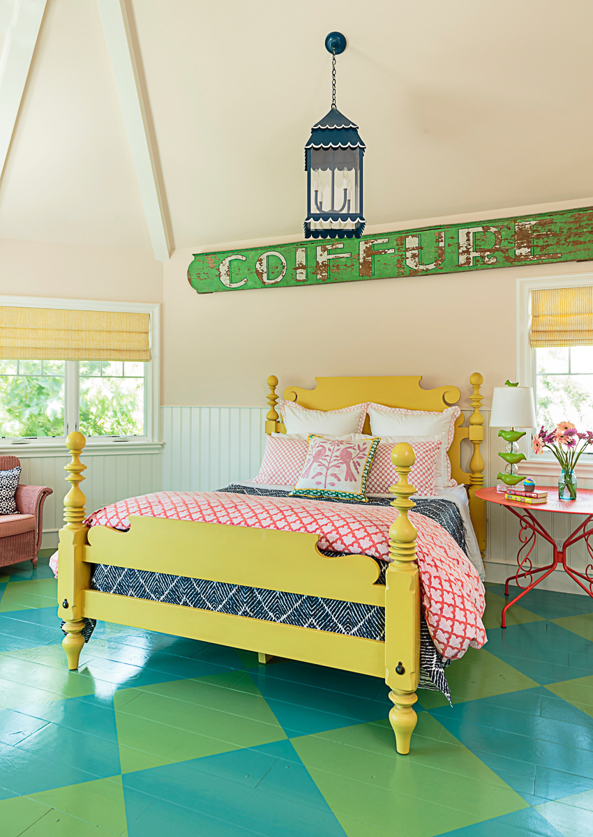 Colorful bedroom with oversized diamond painted wood floor and yellow bed kellyelko.com